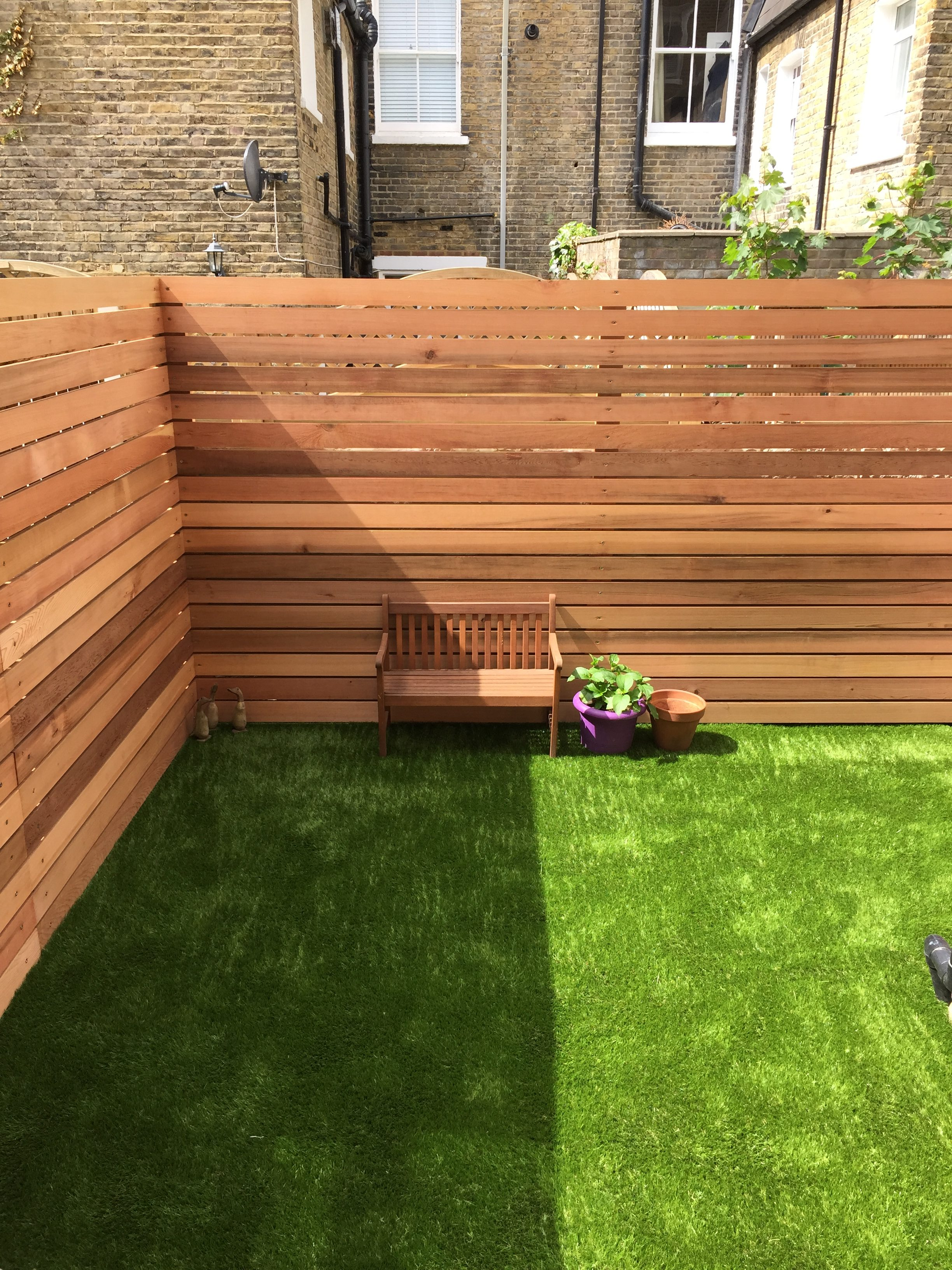Wooden panelling in finished garden